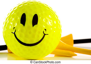 Smiley face golf ball on white background - Yellow smiley...