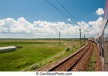Railway goes to horizon in field