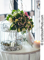 Floral decoration of wedding table. Floral arrangements and...