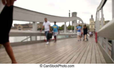 Blurred crowd Crossing Bridge - Crowds of tourists in...