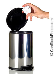 Mans Hand disposing of trash in stainless steel trash can -...