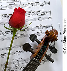 Violin, Rose and sheet music - A violin a single red rose...
