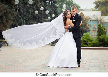 beautiful wedding couple - beautiful brunette bride in white...