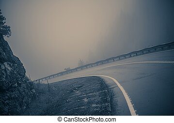 Foggy Curved Road. Dangerous Mountain Road. Bluish Color...