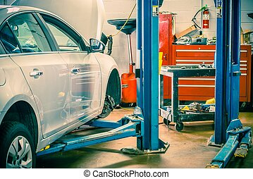Car Servicing Station with Car Lift. Auto Service Interior.