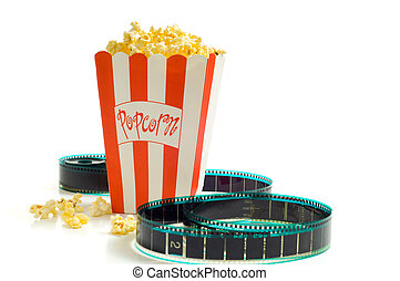 At the Movies - A box of popcorn with a stip of 35mm film on...