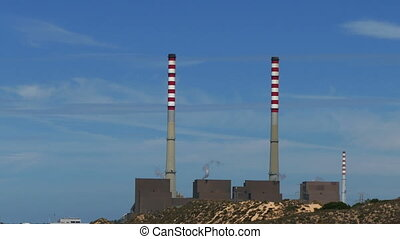 Electric Power Station on blue sky background
