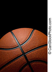 Basketball on black background with copy space