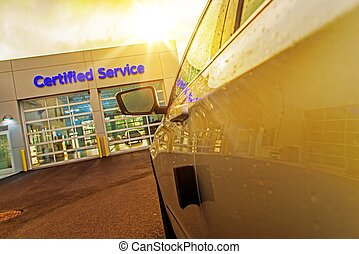 Car Service Auto Care Center. Car in Front of Two Gates to...