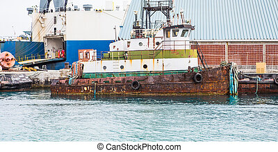 Old Rusty Tugboat at Dock