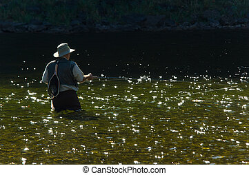 Fisherman on river - Lone fisherman with fishing pole and...
