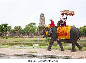 AYUTHAYA THAILAND-SEPTEMBER 6 : tourist riding on elephant...