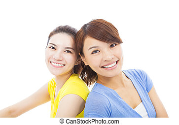 closeup of two happy young girls ov