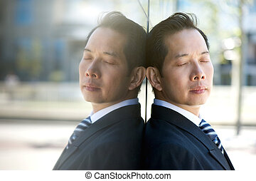 Businessman thinking with eyes closed - Close up portrait of...