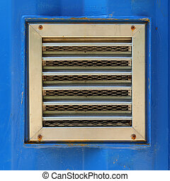 aluminum ventilation on blue cargo container wall