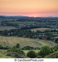 Landscape image Summer sunset view over English countryside...