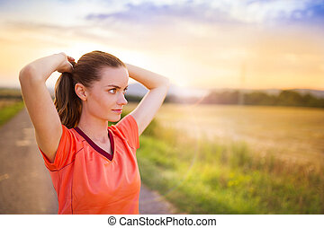 Running woman stretching - Cross-country trail running woman...