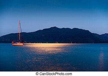 bright light of the moon illuminates the sea surface