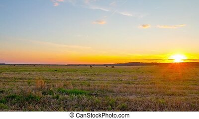 sunset and rural landscape, pan time-lapse