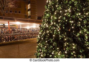 Christamas tree in city near bike parking in Groningen