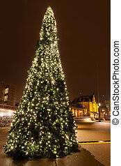 Christamas tree in city near the railway station in...