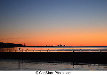 Sunrise over Oakville Harbour - The skyline of Toronto can...
