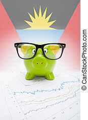 Piggy bank with flag on background - Antigua and Barbuda