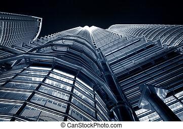 Skyscraper - Petronas Towers at night in Kuala Lumpur,...