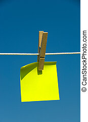 Yellow sticky note on a clothesline