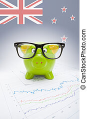 Piggy bank with flag on background - New Zealand