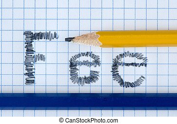 Fee word typed on white paper, yellow and blue pencil.
