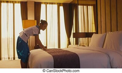 Housemaid cleaning hotel room - Asian housemaid cleaning...