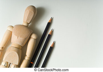 Drawing supplies including drwing pencils a wooden poser on...