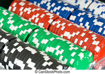 Poker Chip Background - Trays of several denominations of...