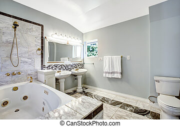 Bathroom with whirlpool bath tub