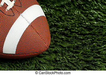 Football on Grass - American football on green artificial...