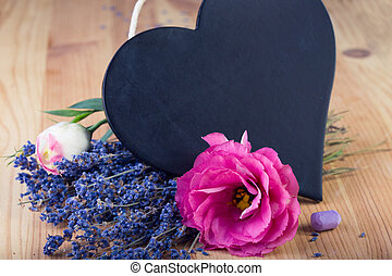 board as heart shape for records with flowers