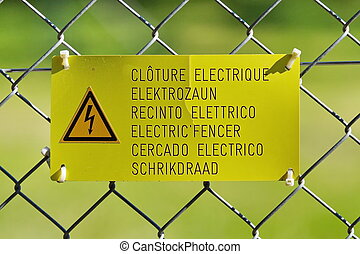 Electric fence sign - Danger high voltage sign on a fence