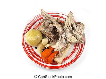 Chicken bones - Cooked chicken bones and vegetables from...
