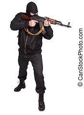 robber in black uniform and mask with kalashnikov isolated