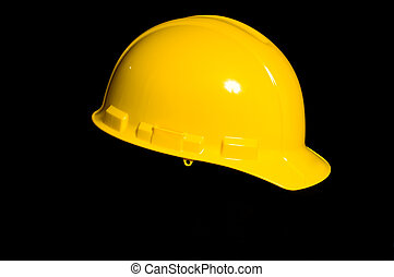 Yellow Hard Hat - Yellow protective hard hat on black...