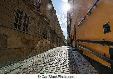Narrow alley in Stockholm - Sunlit narrow alley in Gamla...