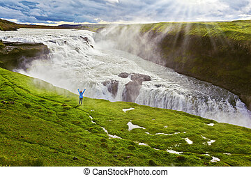 The woman looks at boiling chasm - On a mountain slope the...