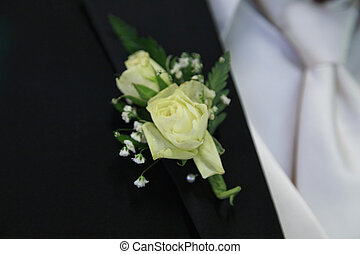 Off White Boutonniere - Off white flowers of this grooms...