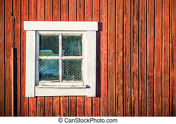 Square white window in old red wooden barn wall - Close up...