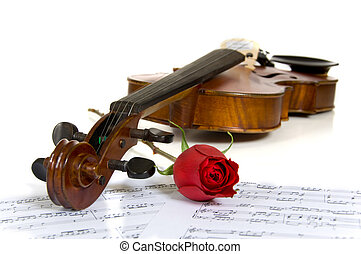 Violin, rose and sheet music - A violin, red rose and sheet...