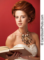Portrait of redhead edvardian women with book on red...