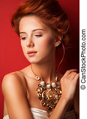 Portrait of redhead edvardian women with necklace on red...