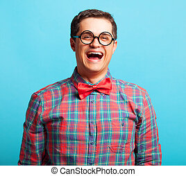 funny nerd with glasses on blue background.