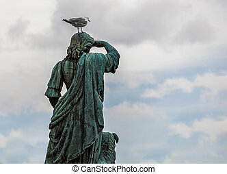 Statue with a seagull on his head - Statue of Flora...